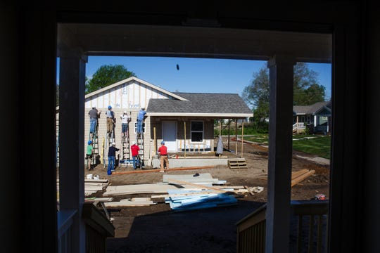 Volunteers with Habitat for Humanity work on a home as part of a community of 23 homes near Birdland Marina on Wednesday, May 22, 2019, in Des Moines. The city of Des Moines is updating its zoning code for the first time in more than 50 years, but some of the changes will make it difficult to build affordable housing in Des Moines.