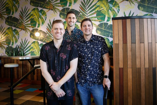 The owners of Bellhop, a new tiki bar in Des Moines East Village, (from left) Nick Tillinghast, Kyle McClain, and Ryan Hitchison, pose for a photo at on Wednesday, May 22, 2019.