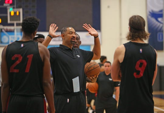 Miami Heat assistant coach Juwan Howard gives instruction to players Bam Adebayo, Hassan Whiteside (21) and Kelly Olynyk (9) during practice on the first day of Miami Heat training camp in preparation for the 2018-19 NBA season at FAU Arena on Tuesday, Sept. 25, 2018 in Boca Raton, Fla. (David Santiago/Miami Herald/TNS)