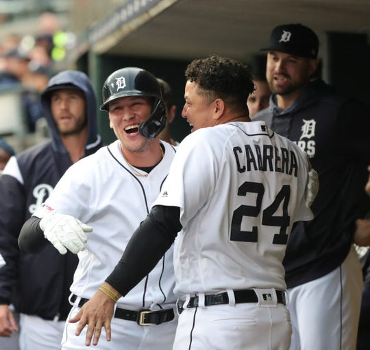 Detroit Tigers center fielder JaCoby Jones and Miguel Cabrera celebrate his homer against Miami Marlins pitcher Caleb Smith during third inning action Tuesday, May 21, 2019 at Comerica Park in Detroit, Mich.