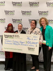 Zaman International COO Gail Zion (left),  Zaman Founder and CEO Najah Bazzy,  Zaman Director of Community Engagement, Monica Boomer and Impact100 Metro Detroit President  Amy Anger at the 4th annual Grant Awards Tuesday, May 21.
