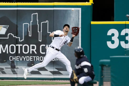 Detroit Tigers right fielder Nicholas Castellanos (9) makes a catch for an out during the fourth inning against the Miami Marlins at Comerica Park.
