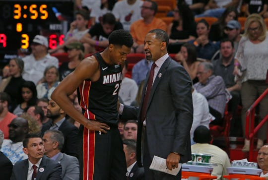 Miami Heat center Hassan Whiteside talks with assistant coach Juwan Howard during the third quarter against the Brooklyn Nets at the AmericanAirlines Arena in Miami on Saturday, March 31, 2018. (David Santiago/El Nuevo Herald/TNS)