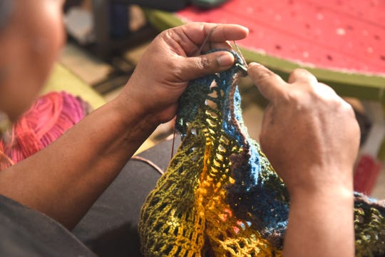 Dahnia Taylor of Ferndale crochets a multicolored  skirt at her home studio.
