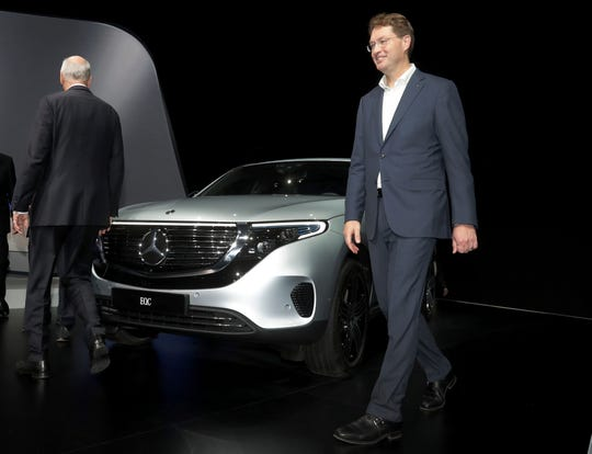 Daimler CEO Dieter Zetsche, left, and incoming Daimler CEO Ola Kaellenius, right, walk past a Mercedes car prior to the annual shareholder meeting of the car manufacturer Daimler in Berlin, Germany, Wednesday, May 22, 2019.