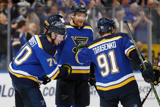 St. Louis Blues center Oskar Sundqvist (70), defenseman Colton Parayko (55) and Vladimir Tarasenko (91) celebrate after the Blues scored a goal against the San Jose Sharks during the third period.