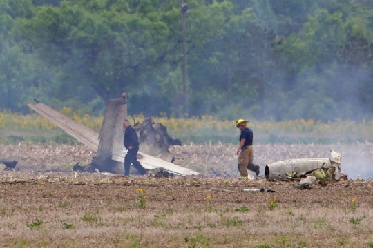 Emergency personnel work at the scene of a plane crash northeast of Indianapolis Regional Airport, Wednesday, May 22, 2019, in Mount Comfort, Ind.