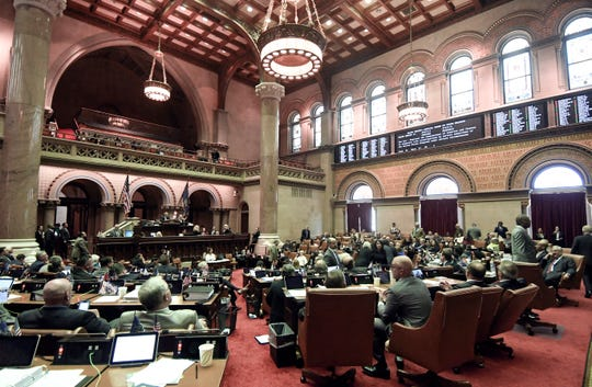 Members of the New York state Assembly vote on legislation that authorizes state tax officials to release, if requested, individual New York state tax returns to Congress,  Wednesday, May 22, 2019, in Albany, N.Y.