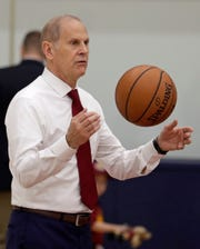 Cleveland Cavaliers head coach John Beilein speaks to players before a news conference Tuesday.