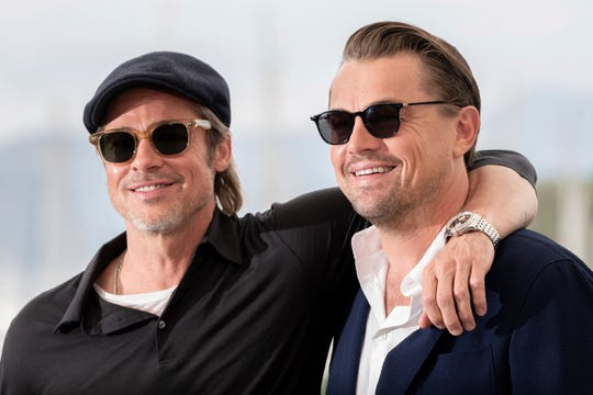 Actors Brad Pitt and Leonardo DiCaprio pose for photographers at the photo call for the film 'Once Upon a Time in Hollywood' at the 72nd international film festival, Cannes, southern France, Wednesday, May 22, 2019.
