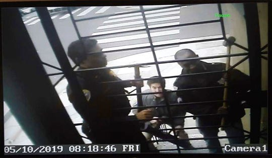 In this May 10, 2019, image from video San Francisco police armed with sledgehammers execute a search warrant at journalist Bryan Carmody's home in San Francisco. The San Francisco reporter is seeking the return of property after police raided his home, as officials sought to determine the source of a leaked police report into the death of the city's public defender.