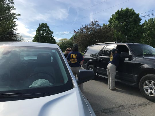 FBI agents, Michigan State Police and Detroit police exhumed unidentified bodies Wednesday at Knollwood Memorial Park Cemetery in an attempt to close old homicide cases.