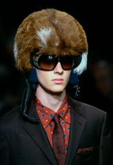 A model shows off a furred helmet during the Prada Fall/Winter 2006/2007 men's fashion collection, presented in Milan, Italy. The Prada Group has become the latest luxury fashion house to go fur-free.