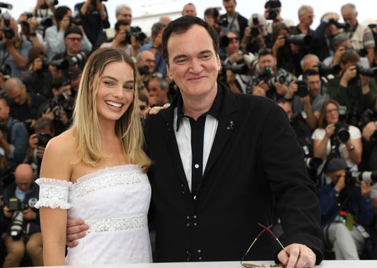 Actress Margot Robbie, left, and director Quentin Tarantino pose for photographers at the photo call for the film 'Once Upon a Time in Hollywood' at the 72nd international film festival, Cannes, southern France, Wednesday, May 22, 2019.