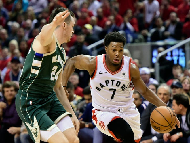 Toronto Raptors guard Kyle Lowry (7) drives for the basket as Milwaukee Bucks guard Pat Connaughton (24) defends during the second half.