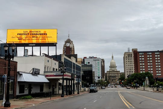 A billboard near the Michigan Capitol paid for by the Coalition Protecting Auto No-Fault.