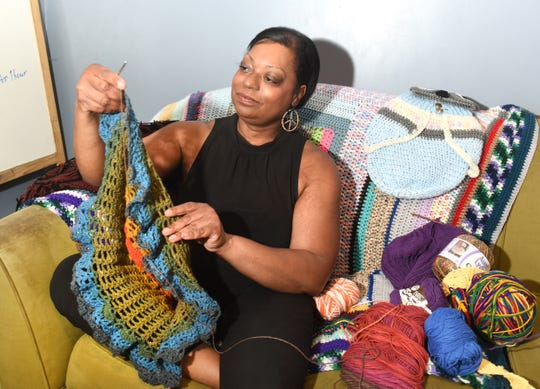 Dahnia Taylor of Ferndale holds her latest crochet skirt at her home studio.
