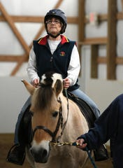 Deb Swartz makes her way around the riding ring on the horse Sigbjorn.