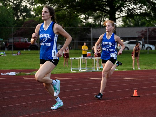 Claire Sievern (left) led Memorial teammate Allison Morphew for most of the 800, but Morphew came back to win in 2:17.61 in the Central Regional on Tuesday. Sievern was second in 2:18.50.