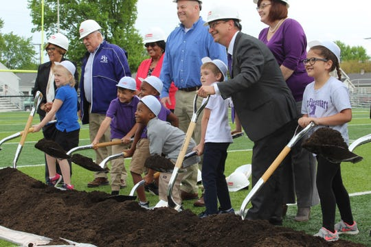 Superintendent Jon Detwiler got a little help from Fremont City Schools board members and students Wednesday, as the school district held an official groundbreaking ceremony for its four new elementary school buildings.