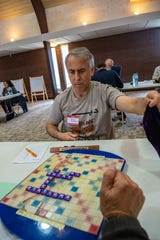 Scrabble player David Goldberg places a bag of tiles on a game table during the Northern Colorado and Denver/Boulder Scrabble Clubs Scrabble Tournament on Saturday, May 18, 2019, at First Christian Church in Loveland, Colo.
