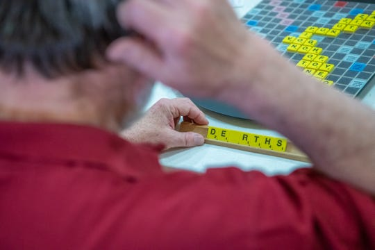 Tom Graim, of Fort Collins, studies his tiles during the Northern Colorado and Denver/Boulder Scrabble Clubs Scrabble Tournament on Saturday, May 18, 2019, at First Christian Church in Loveland, Colo.