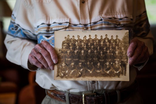World War II 4th Marine Division veteran Walter D Lauttenbach holds a photo of himself and his platoon, the 4th Marine Division, Platoon 1021, during their training in New River, N.C., before being deployed to Maui and eventually participating in the Battle of Iwo Jima, as seen on Wednesday, May 22, 2019, at his and his daughter's home in Fort Collins, Colo.