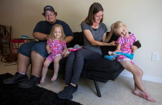 Jonathon Tobbe and Shasta Hardesty play with their daughters Emarah Tobbe, 2, and Lunayrah Hardesty, 4, Wednesday afternoon, May 22, 2019 at their home in Cape Coral. The couple was reunited with their young daughters who had been in foster care for the past two years.