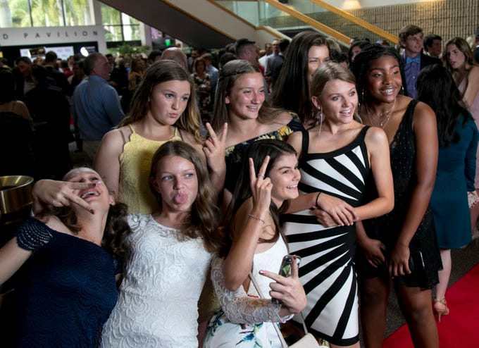 The Seacrest softball team takes a funny photo together before the Southwest Florida Sports Awards on Tuesday, May 21, 2019, at Barbara B. Mann Performing Arts Hall in Fort Myers.