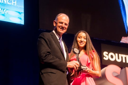 First Baptist Academy's Malaya Melancon was the Naples Daily News Athlete of the Year at the Southwest Florida Sports Awards at Barbara B. Mann Performing Arts Hall on Tuesday May 21, 2019. She poses with Syd Kitson CEO, Founder of Babcock Ranch. She was also named the Naples Daily News Soccer Player of the Year.