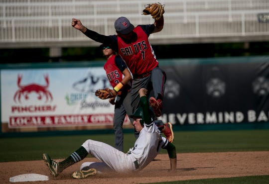 Dan DiNorcia of Seacrest Country Day slides safely under Aiden Driscoll-Sadusky of Wakulla Christian in the FHSAA Class 2A state baseball semifinals on Wednesday, May 22, 2019, at Hammond Stadium in Fort Myers.