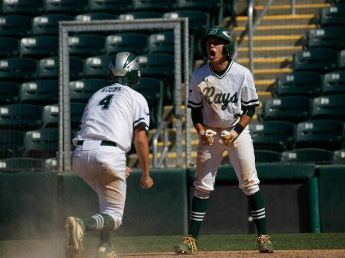 Jordan Martinez, right, of Seacrest Country Day School celebrates scoring runs with Matt Riley on Wednesday, May 22, 2019 in the FHSAA state baseball semifinals against Wakulla Christian at Hammond Stadium in Fort Myers.
