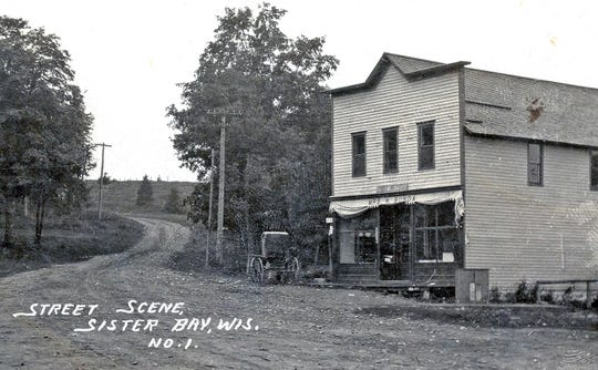 A photo from the early 1900s shows the original Mrs. W. Bunda Store, built in 1890 by Mary and Wenzel Bunda as a general store in Sister Bay. Mitch Larson, the Bundas' great-grandson and owner of On Deck Clothing Co., is remodeling the site as the Village Exchange Building, which will house an On Deck store.