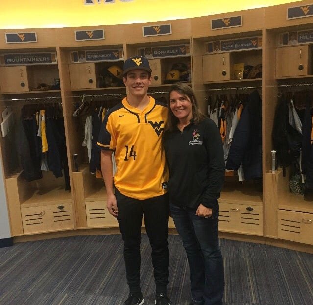 West De Pere junior Ben Hampton poses with his mother, Katie, during a visit to West Virginia.
