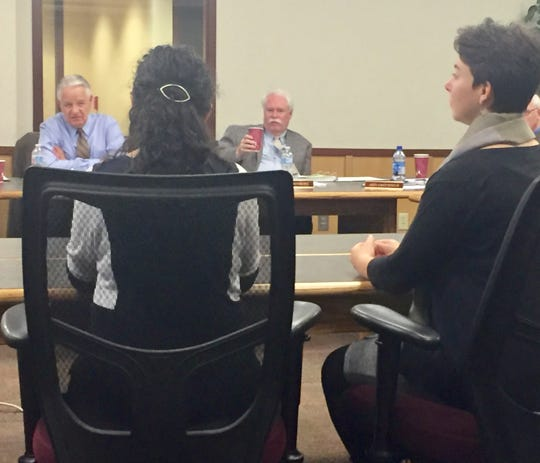 Vicky Juarez, left, speaks Wednesday to the Board of Investments as Laurel Fish looks on.