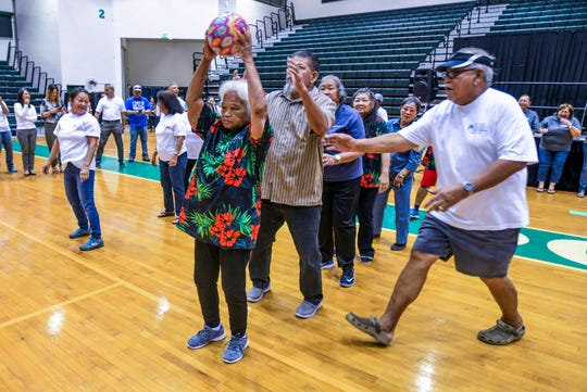 Senior citizen teams compete against each other in a game of Over-Under during the Huegon Manåmko' Carnivale at University of Guam Calvo Field House in Mangilao on Wednesday, May 22, 2019.