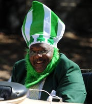 At the annual St. Thomas Aquinas Catholic Church's Irish-Italian Festival Parade, Grand Marshal Eddie Holloway smiles to the crowd, Saturday, March 16, 2013.