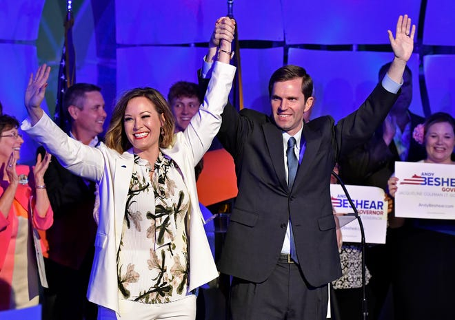 Kentucky Attorney General and Democratic gubernatorial candidate Andy Beshear, right, and his running mate Jacqueline Coleman wave to their supporters following their victory speech in Louisville, Ky., Tuesday night.