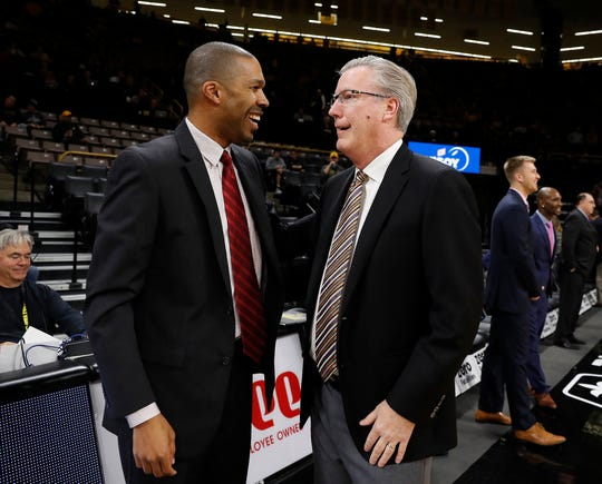 Billy Taylor, left, talks with Iowa head coach Fran McCaffery before a Nov. 2, 2017, exhibition game in Iowa City. Taylor, who was then the head coach at Belmont Abbey, is the newest Hawkeye assistant coach.