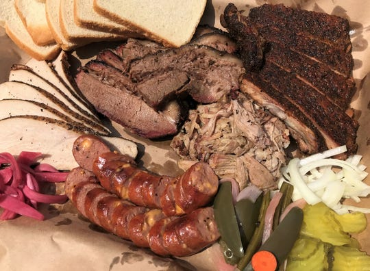Smoked turkey, brisket, ribs, pulled  pork and cheese-studded sausages are served Texas-style at Old Gold Barbecue in Indianapolis.
