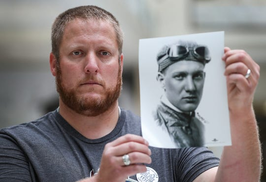Brian Wilcox holds up a photo of his great-grandfather Howdy Wilcox, winner of the 1919 race known then as the Liberty Sweepstakes, at the Indianapolis Motor Speedway Museum on Tuesday, May 22, 2019.