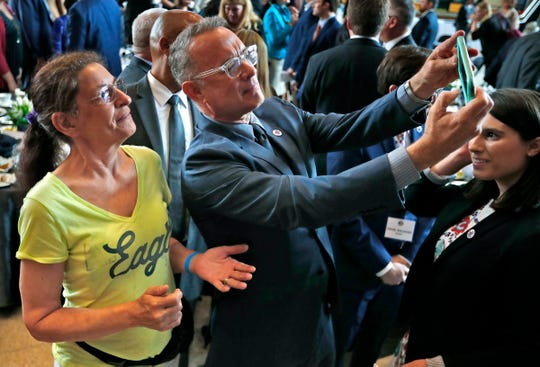 Tom Hanks takes a selfie with Barbara Smith after a luncheon at Bankers Life Fieldhouse honoring military caregivers on May 22, 2019.
