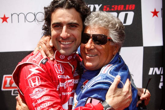Former Indianapolis 500 winners Dario Franchitti, of Scotland,  left, and Mario Andretti hug during an event to promote the Indianapolis 500, in New York, Tuesday, May 25, 2010.  (AP Photo/Seth Wenig)