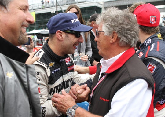 Indy 500 winner Tony Kanaan is congratulated by Mario Andretti following the 97th running of the Indianapolis 500 at Indianapolis Motor Speedway Sunday May 26, 2013. Chris Bergin/ for The Star