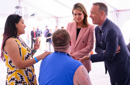 """Today"" co-host Savannah Guthrie, center, and actor Tom Hanks visit with wounded veteran Tim Senkowski, of Anderson, and his wife, Erica, at The Children's Museum of Indianapolis on May 22, 2019."