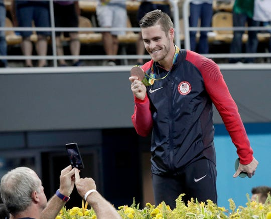 David Boudia celebrates winning the bronze medal in the men's 10m platform diving event during the 2016 Rio 2016 Summer Olympic Games at Maria Lenk Aquatics Centre.