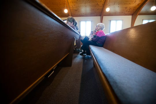 Members of the congregation sit in pews with their animals during the first annual blessing of the animals ceremony, Sunday, May 19, 2019, at Grace United Methodist Church in Tiffin, Iowa.