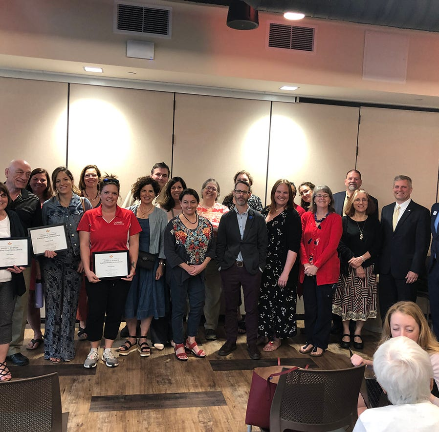 (Left to right) Anne Haus, Daniel Krall, Karli Buday, and the Hangar Theatre board of directors were honored with  with awards for their outstanding volunteer service to the community.