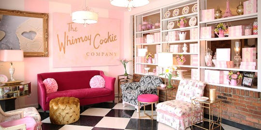 The Whimsy Cookie Company features an interior with pink and white decor.