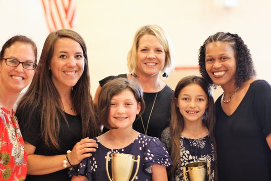 Betsy Castleberry presented the Dixie Cup to two Shannondale Elementary students on May 17. From left: Principal April Partin, fifth grade teacher Martha Pitner, Maggie Wilson, Castleberry, Eden Perkinson, fifth grade teacher Rhoshawnda Turner. 2019